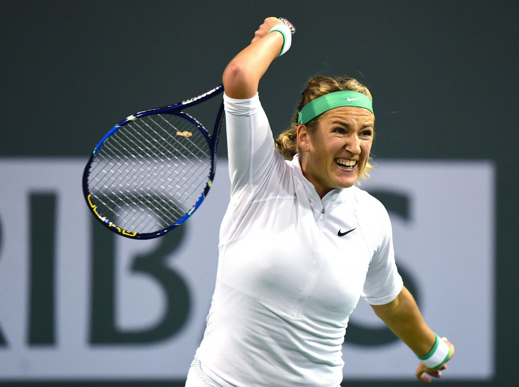 INDIAN WELLS, CA - MARCH 15:  Victoria Azarenka of Belarus reacts to her forehand during her match against Samantha Stosur of Australia at Indian Wells Tennis Garden on March 15, 2016 in Indian Wells, California.  (Photo by Harry How/Getty Images)
