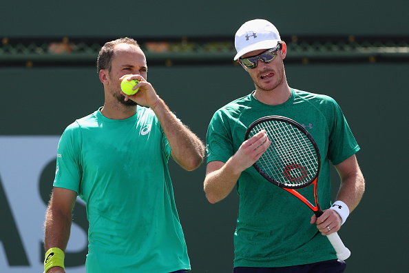 INDIAN WELLS, CA - MARCH 15:  Jamie Murray of Great Britain and Bruno Soares of Brazil talk tactics in their match against Dominic Inglot of Great Britain and Robert Lindstedt of Sweden in the doubles during day nine of the BNP Paribas Open at Indian Wells Tennis Garden on March 15, 2016 in Indian Wells, California.  (Photo by Julian Finney/Getty Images)