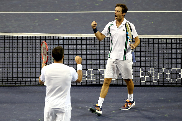INDIAN WELLS, CA - MARCH 16:  Nenad Zimonjic of Serbia and Edauard Roger-Vasselin of France celebrate match point against Mike Bryan and Bob Bryan during the BNP Paribas Open at the Indian Wells Tennis Garden on March 16, 2016 in Indian Wells, California.  (Photo by Matthew Stockman/Getty Images)