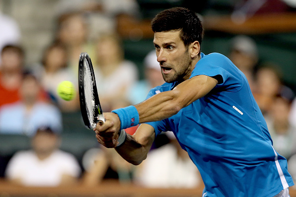 INDIAN WELLS, CA - MARCH 15:  Novak Djokovic of Serbia returns  shot to Philipp Kohlschreiber of Germany during the BNP Paribas Open at the Indian Wells Tennis Garden on March 15, 2016 in Indian Wells, California.  (Photo by Matthew Stockman/Getty Images)