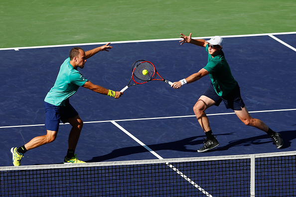 INDIAN WELLS, CA - MARCH 17:  Jamie Murray of Great Britain and Bruno Soares of Brazil in action against Feliciano Lopez and Marc Lopez of Spain in the doubles during day eleven of the BNP Paribas Open at Indian Wells Tennis Garden on March 17, 2016 in Indian Wells, California.  (Photo by Julian Finney/Getty Images)