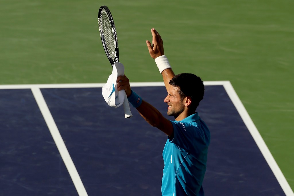 INDIAN WELLS, CA - MARCH 18:  Novak Djokovic of Serbia celebrates his win over Jo-Wilfried Tsonga of France during the BNP Paribas Open at the Indian Wells Tennis Garden on March 18, 2016 in Indian Wells, California.  (Photo by Matthew Stockman/Getty Images)