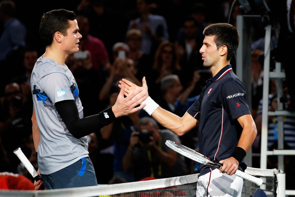 PARIS, FRANCE - NOVEMBER 02:  Winner, Novak Djokovic (R) of Serbia and runner-up,  Milos Raonic (L) of Canada shake hands after their Final match during day 7 of the BNP Paribas Masters held at the at Palais Omnisports de Bercy on November 2, 2014 in Paris, France.  (Photo by Dean Mouhtaropoulos/Getty Images)