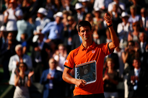 PARIS, FRANCE - JUNE 07:  Novak Djokovic of Serbia salutes the crowd after collecting the runners up trophy after defeat in the Men's Singles Final against Stanislas Wawrinka of Switzerland on day fifteen of the 2015 French Open at Roland Garros on June 7, 2015 in Paris, France.  (Photo by Dan Istitene/Getty Images)