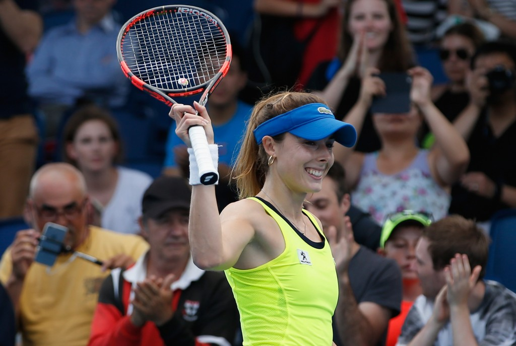 MELBOURNE, AUSTRALIA - JANUARY 19:  Alize Cornet of France celebrates winning her first round match against Bojana Jovanovski of Serbia during day two of the 2016 Australian Open at Melbourne Park on January 19, 2016 in Melbourne, Australia.  (Photo by Darrian Traynor/Getty Images)
