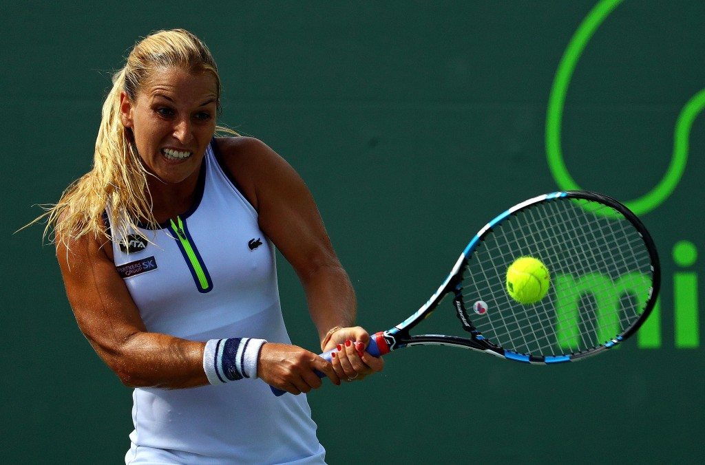 KEY BISCAYNE, FL - MARCH 23:  Dominika Cibulkova of Slovakia plays a match against Johanna Larsson of Sweden during Day 3 of the Miami Open presented by Itau at Crandon Park Tennis Center on March 23, 2016 in Key Biscayne, Florida.  (Photo by Mike Ehrmann/Getty Images)