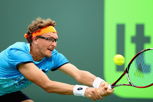 KEY BISCAYNE, FL - MARCH 24:  Denis Istomin of Uzbekistan plays a backhand against Borna Coric of Croatia in their first round match during the Miami Open Presented by Itau at Crandon Park Tennis Center on March 24, 2016 in Key Biscayne, Florida.  (Photo by Clive Brunskill/Getty Images)