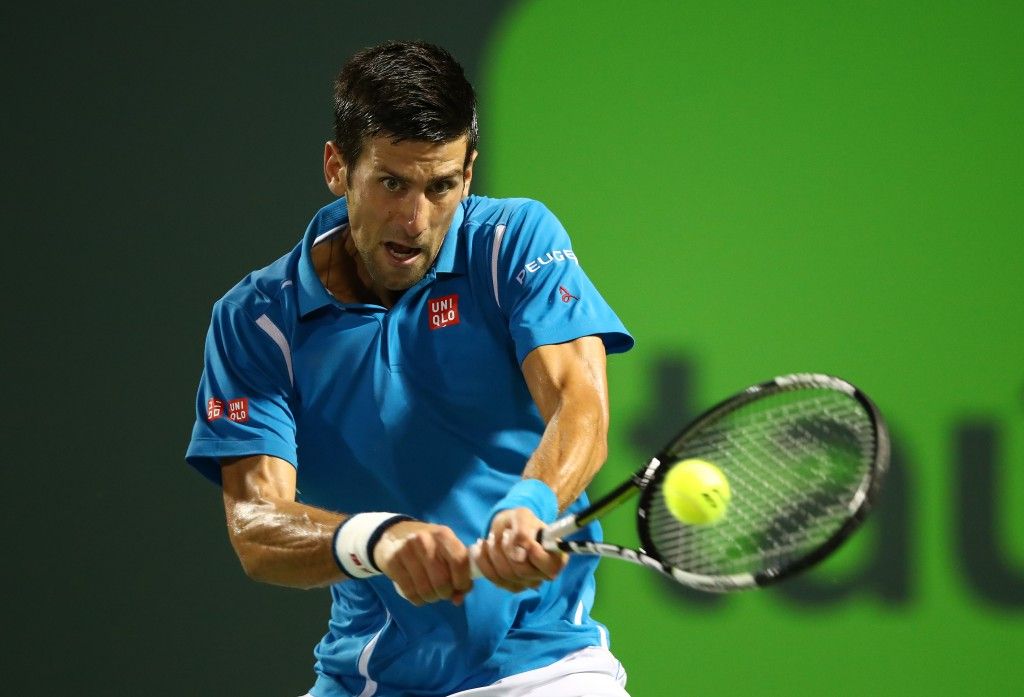 KEY BISCAYNE, FL - MARCH 25:  Novak Djokovic of Serbia plays a backhand against  Kyle Edmund of Great Britain in their second round match during the Miami Open Presented by Itau at Crandon Park Tennis Center at Crandon Park Tennis Center on March 25, 2016 in Key Biscayne, Florida.  (Photo by Clive Brunskill/Getty Images)
