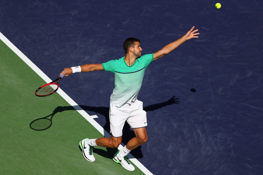 INDIAN WELLS, CA - MARCH 13:  Grigor Dimitrov of Bulgaria in action in his match against Alexander Zverev of Germany during day seven of the BNP Paribas Open at Indian Wells Tennis Garden on March 13, 2016 in Indian Wells, California.  (Photo by Julian Finney/Getty Images)