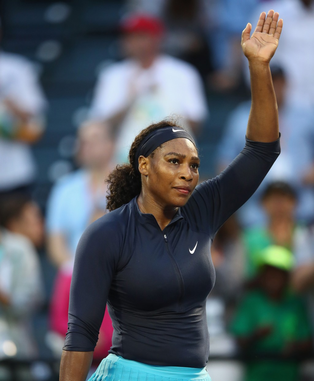 KEY BISCAYNE, FL - MARCH 24:  Serena Williams of the United States waves to the crowd after her three set victory against Christina McHale of the United States in their second round match during the Miami Open Presented by Itau at Crandon Park Tennis Center on March 24, 2016 in Key Biscayne, Florida.  (Photo by Clive Brunskill/Getty Images)