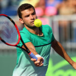 KEY BISCAYNE, FL - MARCH 26:  Grigor Dimitrov of Bulgaria in action against Federico Delbonis of Argentina in their second round match during the Miami Open Presented by Itau at Crandon Park Tennis Center on March 26, 2016 in Key Biscayne, Florida.  (Photo by Clive Brunskill/Getty Images)