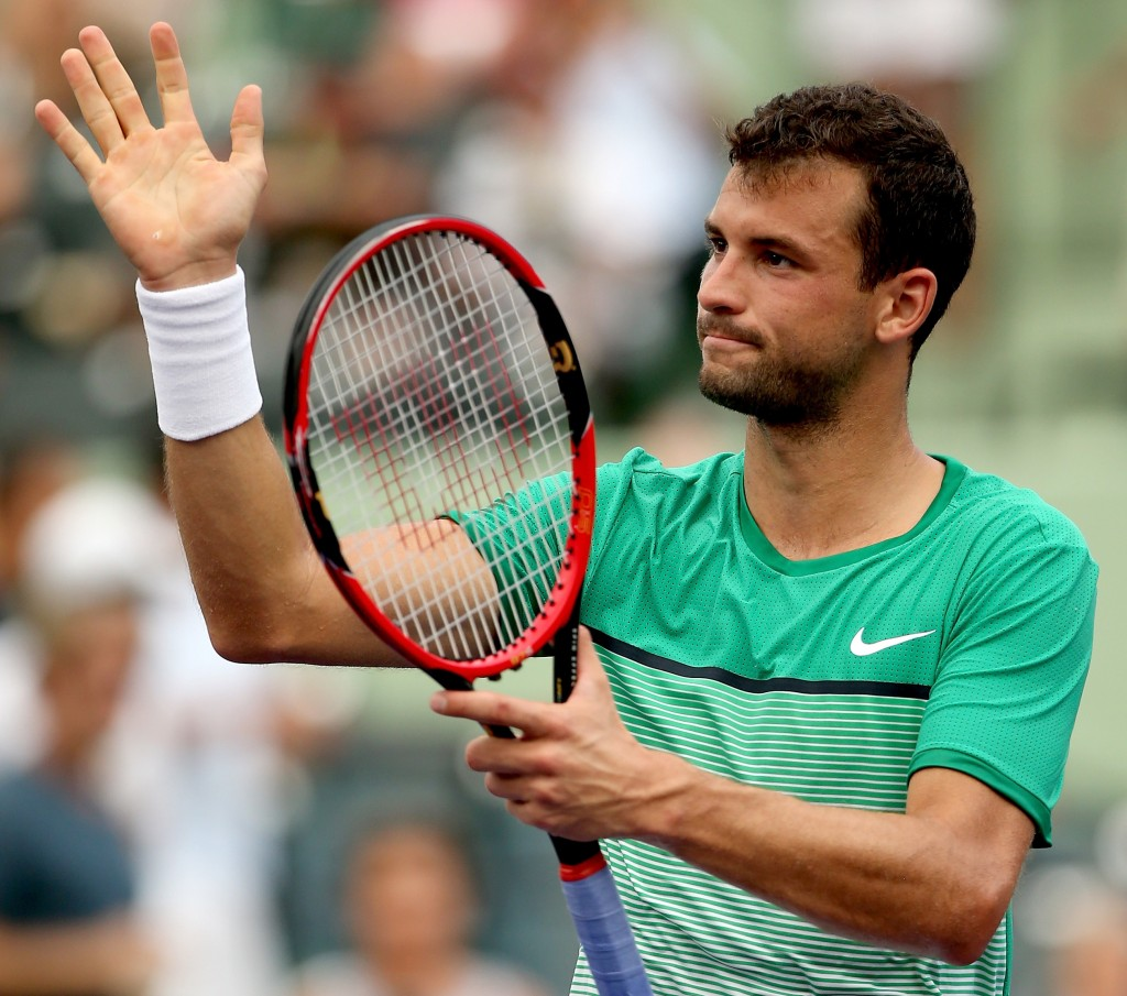 KEY BISCAYNE, FL - MARCH 28:  Grigor Dimitrov of Bulgaria celebrates celebrates his win over Andy Murray of Great Britain during the Miami Open presented by Itau at Crandon Park Tennis Center on March 28, 2016 in Key Biscayne, Florida.  (Photo by Matthew Stockman/Getty Images)