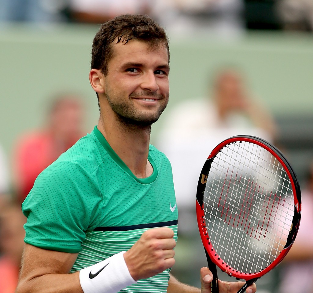 KEY BISCAYNE, FL - MARCH 28:  Grigor Dimitrov of Bulgaria celebrates match point against Andy Murray of Great Britain during the Miami Open presented by Itau at Crandon Park Tennis Center on March 28, 2016 in Key Biscayne, Florida.  (Photo by Matthew Stockman/Getty Images)
