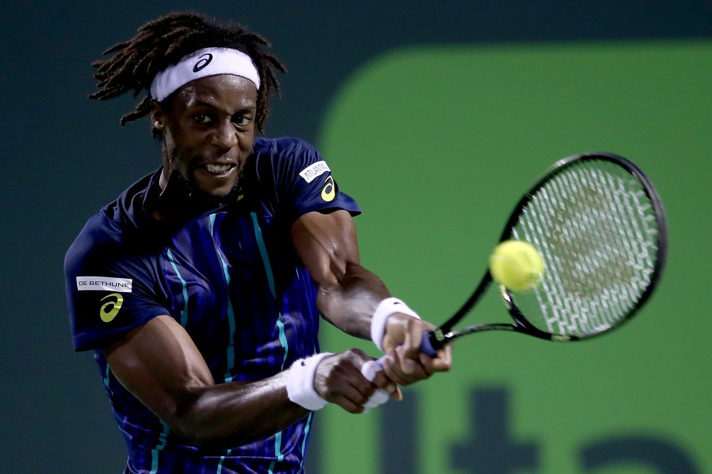 KEY BISCAYNE, FL - MARCH 28:  Gael Monfils of France plays Pablo Cuevas of Uraguay during the Miami Open presented by Itau at Crandon Park Tennis Center on March 28, 2016 in Key Biscayne, Florida.  (Photo by Matthew Stockman/Getty Images)