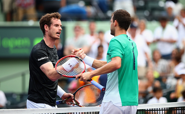 KEY BISCAYNE, FL - MARCH 28:  Grigor Dimitrov of Bulgaria shakes hands at the net after his three set victory against Andy Murray of Great Britain in their third round match during the Miami Open Presented by Itau at Crandon Park Tennis Center on March 28, 2016 in Key Biscayne, Florida.  (Photo by Clive Brunskill/Getty Images)