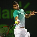 KEY BISCAYNE, FL - MARCH 29:  Grigor Dimitrov of Bulgaria plays a forehand against Gael Monfils of France in their fourth round match during the Miami Open Presented by Itau at Crandon Park Tennis Center on March 29, 2016 in Key Biscayne, Florida.  (Photo by Clive Brunskill/Getty Images)
