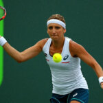 KEY BISCAYNE, FL - MARCH 29:  Timea Bacsinszky of Switzerland plays a match against Simona Halep of Romania during Day 9 of the Miami Open presented by Itau at Crandon Park Tennis Center on March 29, 2016 in Key Biscayne, Florida.  (Photo by Mike Ehrmann/Getty Images)