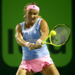 KEY BISCAYNE, FL - MARCH 29:  Svetlana Kuznetsova of Russia returns a shot to Ekatarina Makarova of Russia during the Miami Open presented by Itau at Crandon Park Tennis Center on March 29, 2016 in Key Biscayne, Florida.  (Photo by Matthew Stockman/Getty Images)