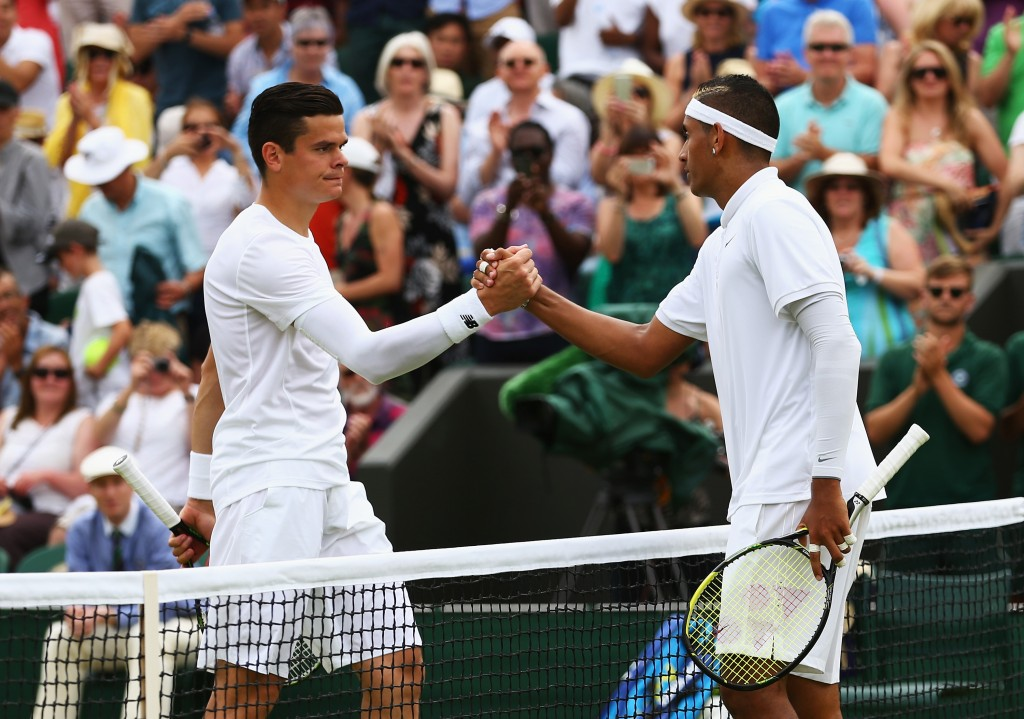 LONDON, ENGLAND - JULY 03:  Milos Raonic of Canada (R) congratulates Nick Kyrgios of Australia on victory at the net after their Gentlemen's Singles Third Round match during day five of the Wimbledon Lawn Tennis Championships at the All England Lawn Tennis and Croquet Club on July 3, 2015 in London, England.  (Photo by Clive Brunskill/Getty Images)