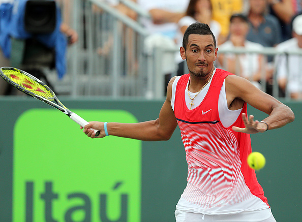 Austarlia's Nick Kyrgios returns a shot against Russia's Andrey Kznetsov during the fourth round of the Miami Open at Crandon Park Tennis Center in Key Biscayne, Fla., on Tuesday, March 29, 2016. Kyrgios advanced, 7-6, 6-3. (Pedro Portal/El Nuevo Herald/TNS via Getty Images)