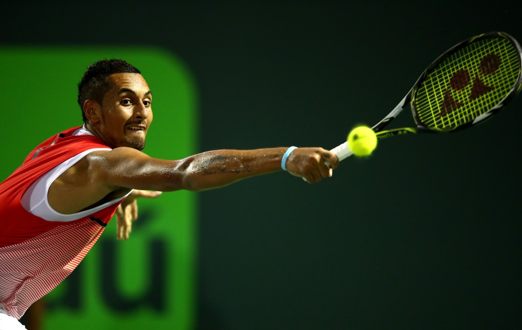 KEY BISCAYNE, FL - MARCH 31:  Nick Kyrgios of Australia in action against Milos Raonic of Canada in their quarter final match during the Miami Open Presented by Itau at Crandon Park Tennis Center on March 31, 2016 in Key Biscayne, Florida.  (Photo by Clive Brunskill/Getty Images)