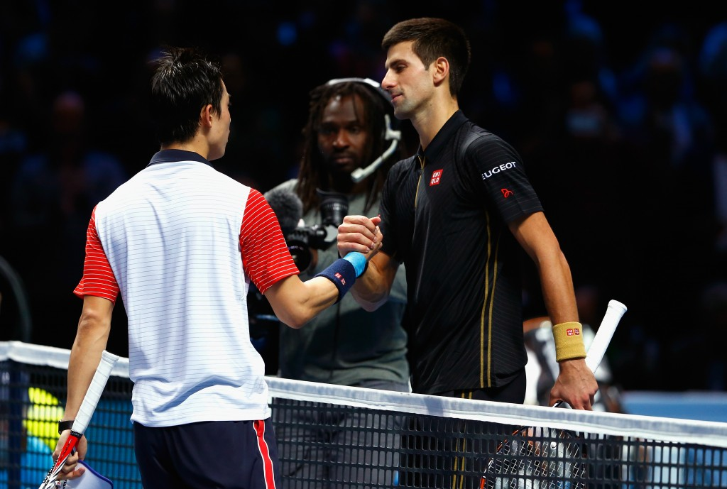 LONDON, ENGLAND - NOVEMBER 15:  Kei Nishikori of Japan shakes hands with Novak Djokovic of Serbia after the singles semi-final match on day seven of the Barclays ATP World Tour Finals at O2 Arena on November 15, 2014 in London, England.  (Photo by Julian Finney/Getty Images)