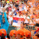 KEY BISCAYNE, FL - APRIL 03:  Novak Djokovic of Serbia holds aloft the Butch Buchholz trophy after his straight sets victory against Kei Nishikori of Japan in the mens final during the Miami Open Presented by Itau at Crandon Park Tennis Center on April 3, 2016 in Key Biscayne, Florida.  (Photo by Clive Brunskill/Getty Images)