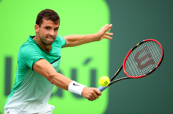 KEY BISCAYNE, FL - MARCH 28:  Grigor Dimitrov of Bulgaria plays a backhand against Andy Murray of Great Britain in their third round match during the Miami Open Presented by Itau at Crandon Park Tennis Center on March 28, 2016 in Key Biscayne, Florida.  (Photo by Clive Brunskill/Getty Images)