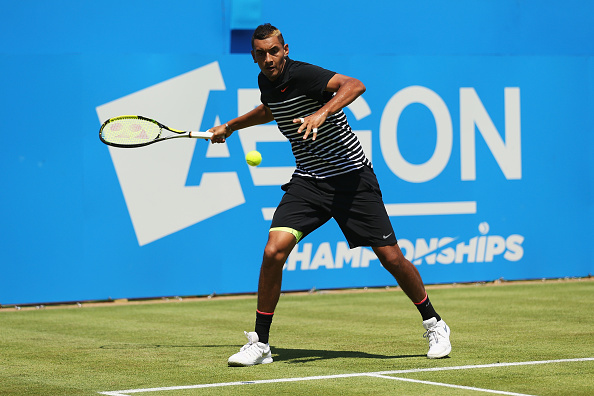 LONDON, ENGLAND - JUNE 16:  Nick Kyrgios of Australia plays a forehand in his men's singles first round match against Stanislas Wawrinka of Switzerland during day two of the Aegon Championships at Queen's Club on June 16, 2015 in London, England.  (Photo by Clive Brunskill/Getty Images)