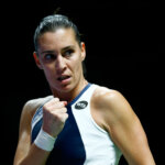 SINGAPORE - OCTOBER 27:  Flavia Pennetta of Italy celebrates a point against Agnieszka Radwanska of Poland in a round robin match during the BNP Paribas WTA Finals at Singapore Sports Hub on October 27, 2015 in Singapore.  (Photo by Julian Finney/Getty Images)