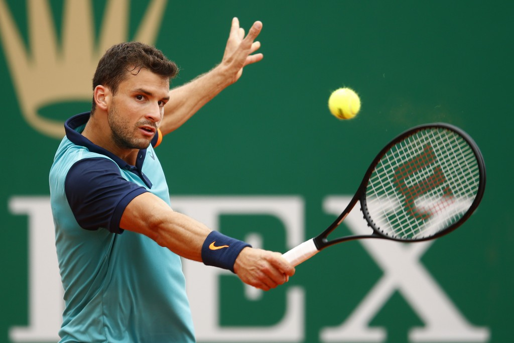 MONTE-CARLO, MONACO - APRIL 15:  Grigor Dimitrov of Bulgaria in action against Fabio Fognini of Italy during day four of the Monte Carlo Rolex Masters tennis at the Monte-Carlo Sporting Club on April 15, 2015 in Monte-Carlo, Monaco.  (Photo by Julian Finney/Getty Images)