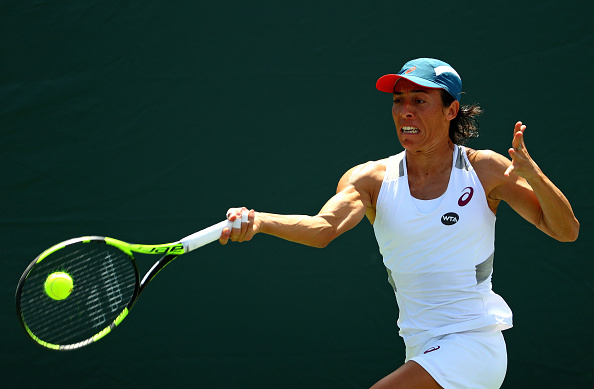 KEY BISCAYNE, FL - MARCH 23:  Francesca Schiavone of Italy plays a match against Irina Falconi during Day 3 of the Miami Open presented by Itau at Crandon Park Tennis Center on March 23, 2016 in Key Biscayne, Florida.  (Photo by Mike Ehrmann/Getty Images)