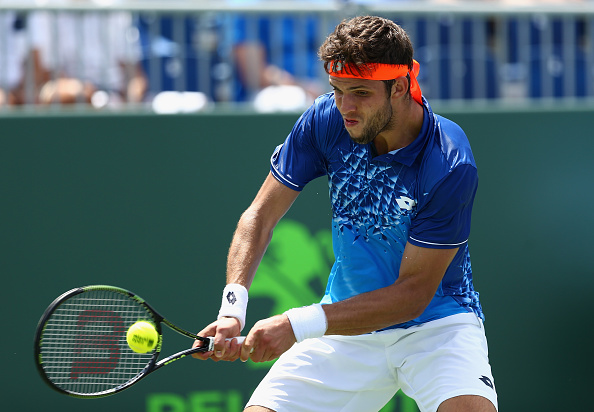 KEY BISCAYNE, FL - MARCH 23:  Jiri Vesely of the Czech Republic plays a backhand against Kyle Edmund of Great Britaiin in their first round match during the Miami Open Presented by Itau at Crandon Park Tennis Center at Crandon Park Tennis Center on March 23, 2016 in Key Biscayne, Florida.  (Photo by Clive Brunskill/Getty Images)