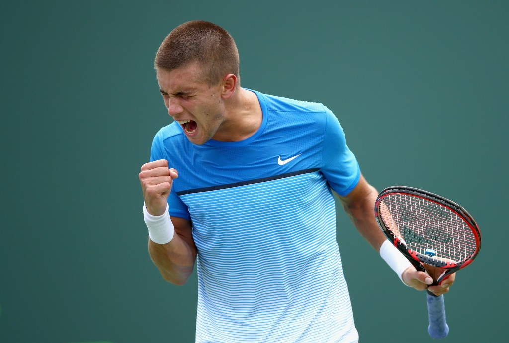 KEY BISCAYNE, FL - MARCH 24:  Borna Coric of Croatia celebrates a point against Denis Istomin of Uzbekistan in their first round match during the Miami Open Presented by Itau at Crandon Park Tennis Center on March 24, 2016 in Key Biscayne, Florida.  (Photo by Clive Brunskill/Getty Images)