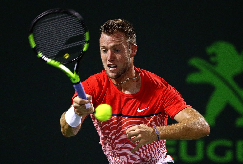 KEY BISCAYNE, FL - MARCH 28:  Jack Sock plays a match against Milos Raonic of Canada during Day 8 of the Miami Open presented by Itau at Crandon Park Tennis Center on March 28, 2016 in Key Biscayne, Florida.  (Photo by Mike Ehrmann/Getty Images)