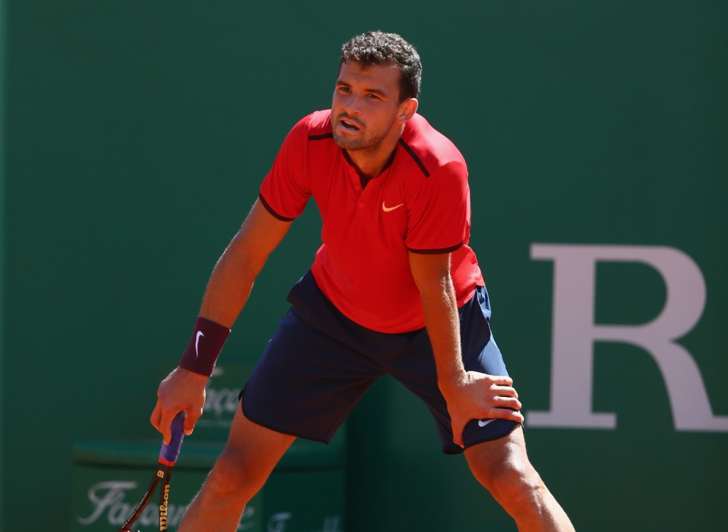 MONTE-CARLO, MONACO - APRIL 12: Grigor Dimitrov of Bulgaria is frustrated during his 4-6,3-6 defeat  against Grigor Dimitrov of Bulgaria during day three of the Monte Carlo Rolex Masters at Monte-Carlo Sporting Club on April 12, 2016 in Monte-Carlo, Monaco.  (Photo by Michael Steele/Getty Images)