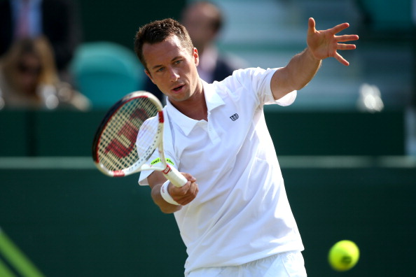 STOKE POGES, ENGLAND - JUNE 18:  Philip Kohlschreiber of Germany plays a forehand against Fabio Fognini of Italy during day two of The Boodles Tennis Event at Stoke Park on June 17, 2014 in Stoke Poges, England.  (Photo by Jordan Mansfield/Getty Images)