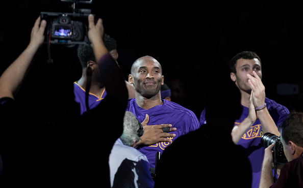 OKLAHOMA CITY, OK - APRIL 11: Kobe Bryant #24 of the Los Angeles Lakers greets fans during a NBA game at the Chesapeake Energy Arena against the Oklahoma City Thunder  on April 11, 2016 in Oklahoma City, Oklahoma. NOTE TO USER: User expressly acknowledges and agrees that, by downloading and or using this photograph, User is consenting to the terms and conditions of the Getty Images License Agreement. (Photo by J Pat Carter/Getty Images)