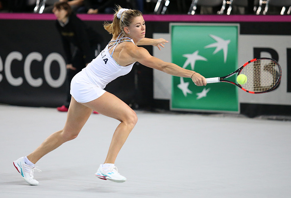 MARSEILLE, FRANCE - FEBRUARY 7: Camila Giorgi of Italy in action during day 2 of the Fed Cup World Group tie between France and Italy at Palais des Sports on February 7, 2016 in Marseille, France. (Photo by Jean Catuffe/Getty Images)
