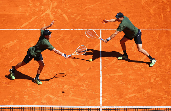 MONTE-CARLO, MONACO - APRIL 14:  Bob Bryan of the United States (R) and Mike Bryan of the United States in action during the round two doubles match against Juan Sebastian Cabal of Colombia and Robert Farah of Colombia on day five of Monte Carlo Rolex Masters at Monte-Carlo Sporting Club on April 14, 2016 in Monte-Carlo, Monaco.  (Photo by Michael Steele/Getty Images)