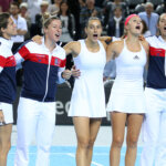 MARSEILLE, FRANCE - FEBRUARY 7: Captain of France Amelie Mauresmo, Pauline Parmentier, Caroline Garcia, Kristina Mladenovic and Oceane Dodin of France celebrate their victory during day 2 of the Fed Cup World Group tie between France and Italy at Palais des Sports on February 7, 2016 in Marseille, France. (Photo by Jean Catuffe/Getty Images)