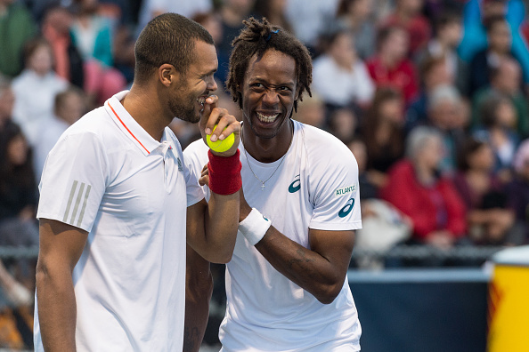 MONTREAL, ON - AUGUST 11:  Jo-Wilfried Tsonga and teammate Gael Monfils of France have a laugh during day two of the Rogers Cup against Lleyton Hewitt and Nick Kyrgios of Australia at Uniprix Stadium on August 11, 2015 in Montreal, Quebec, Canada.  (Photo by Minas Panagiotakis/Getty Images)