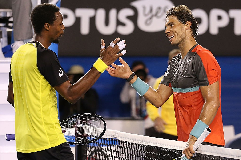 MELBOURNE, AUSTRALIA - JANUARY 18:  Rafael Nadal (R) of Spain celebrates his win in his third round match against Gael Monfils of France during day six of the 2014 Australian Open at Melbourne Park on January 18, 2014 in Melbourne, Australia.  (Photo by Michael Dodge/Getty Images)