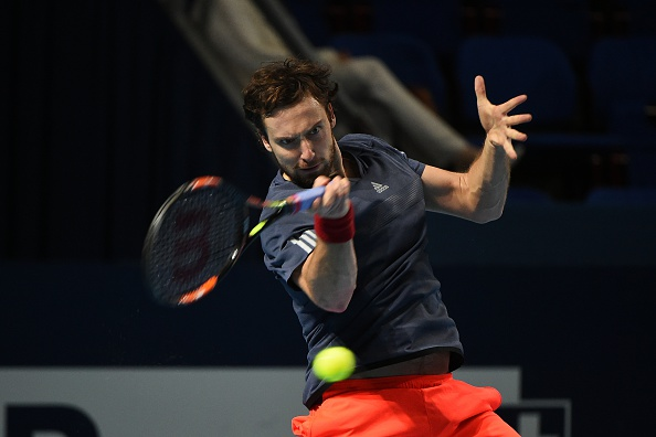 BASEL, SWITZERLAND - OCTOBER 27: Ernests Gulbis of Latvia in action in his loss to John Isner of USA at the Swiss Indoors Basel at St. Jakobshalle on October 27, 2015 in Basel, Switzerland.  (Photo by Peter Staples/ATP World Tour/ATP via Getty Images).