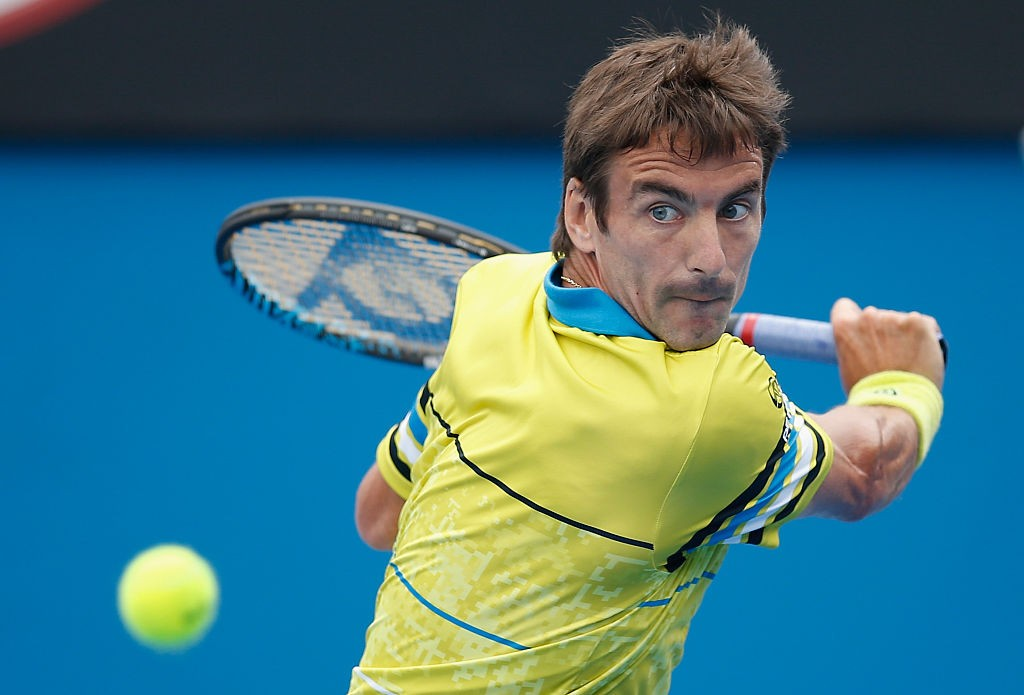 MELBOURNE, AUSTRALIA - JANUARY 21:  Tommy Robredo of Spain plays a backhand in his second round match against Milos Raonic of Canada during day four of the 2016 Australian Open at Melbourne Park on January 21, 2016 in Melbourne, Australia.  (Photo by Darrian Traynor/Getty Images)