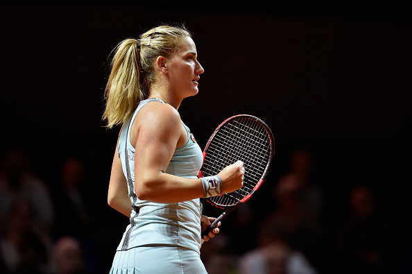 STUTTGART, GERMANY - APRIL 18:  Timea Babos of Hungary celebrates a point in her match against Sabine Lisicki of Germany uring Day 1 of the Porsche Tennis Grand Prix at Porsche-Arena on April 18, 2016 in Stuttgart, Germany.  (Photo by Dennis Grombkowski/Bongarts/Getty Images)