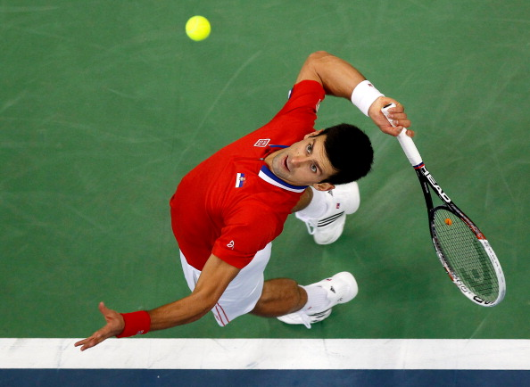 BELGRADE, SERBIA - NOVEMBER 15: Novak Djokovic of Serbia serves the ball to Radek Stepanek of Czech Republic during the day one of the final Davis Cup match between Serbia and Czech Republic at Kombank Arena on November 15, 2013 in Belgrade, Serbia. (Photo by Srdjan Stevanovic/Getty Images)