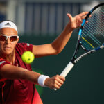 KEY BISCAYNE, FL - MARCH 22:  Kirsten Flipkens of Belgium  plays a backhand during her first round match against Laura Robson of Great Britain during the Miami Open Presented by Itau at Crandon Park Tennis Center at Crandon Park Tennis Center on March 22, 2016 in Key Biscayne, Florida.  (Photo by Clive Brunskill/Getty Images)