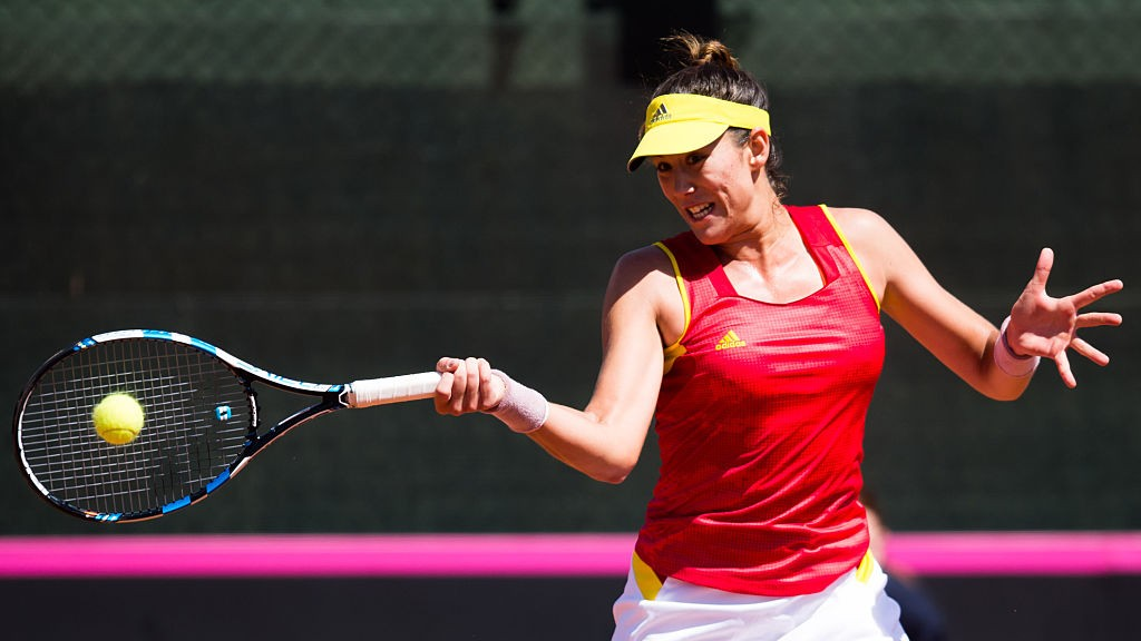 LLEIDA, SPAIN - APRIL 17: Garbine Muguruza of Spain plays a forehand against Roberta Vinci of Italy during day two of the Fed Cup World Group Play-off Round match between Spain and Italy on April 17, 2016 in Lleida, Spain. (Photo by Alex Caparros/Getty Images)