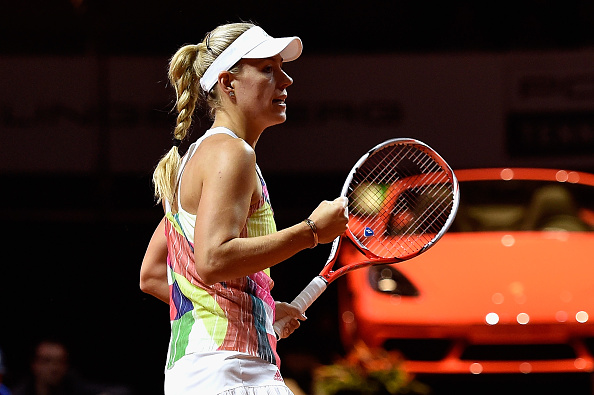 STUTTGART, GERMANY - APRIL 22:  Angelique Kerber of Germany celebrates a point in her match against Carla Suarez Navarro of Spain during Day 5 of the Porsche Tennis Grand Prix at Porsche-Arena on April 22, 2016 in Stuttgart, Germany.  (Photo by Dennis Grombkowski/Bongarts/Getty Images)